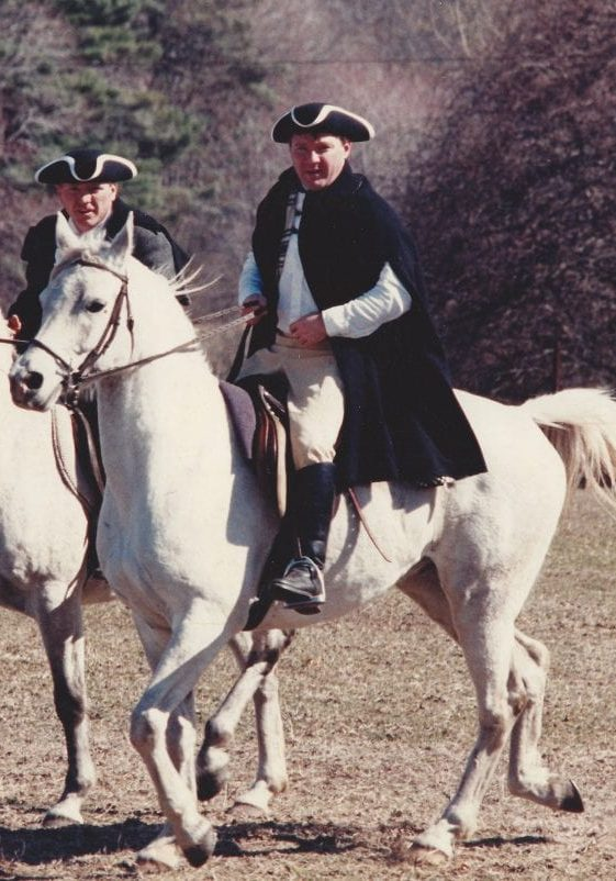 2 lancers riding white horses